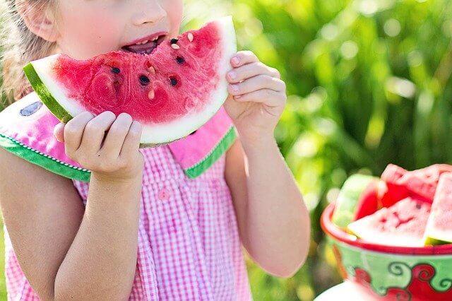 Little Girl Eating a Summer Fruit Watermelon